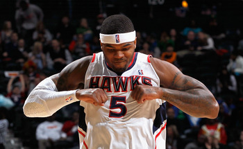 ATLANTA, GA - FEBRUARY 12:  Josh Smith #5 of the Atlanta Hawks reacts after hitting a three-point basket against the Charlotte Bobcats at Philips Arena on February 12, 2011 in Atlanta, Georgia.  NOTE TO USER: User expressly acknowledges and agrees that, b