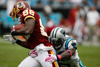 CHARLOTTE, NC - OCTOBER 11:  Fred Davis #86 of Washington Redskins is tackled by Jon Beason #52 of the Carolina Panthers at Bank of America Stadium on October 11, 2009 in Charlotte, North Carolina.  (Photo by Streeter Lecka/Getty Images)