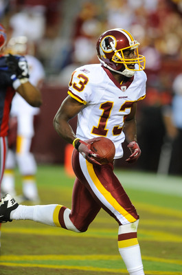 LANDOVER, MD - AUGUST 13:  Anthony Armstrong #13 of the Washington Redskins celebrates after scoring a touchdown during the preseason game against the Buffalo Bills at FedEx Field on August 13, 2010 in Landover, Maryland.  (Photo by Greg Fiume/Getty Image