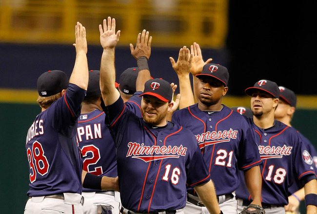ST. PETERSBURG, FL - APRIL 17:  Jason Kubel #16 of the Minnesota Twins is congratulated by his teammates after their victory over the Tampa Bay Rays at Tropicana Field on April 17, 2011 in St. Petersburg, Florida.  (Photo by J. Meric/Getty Images)