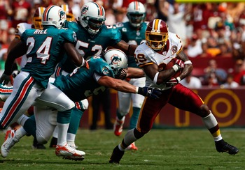 WASHINGTON - SEPTEMBER 09:  Wide receiver Santana Moss #89 of the Washington Redskins is gang tackled by Miami Dolphins defense in third quarter action at FedEx Field September 9, 2007 in Landover, Maryland.  The Redskins defeated the Dolphins 16-13.  (Ph