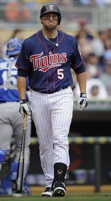 MINNEAPOLIS, MN - APRIL 13: Michael Cuddyer #5 of the Minnesota Twins reacts to a strikeout with the bases loaded against the Kansas City Royals during the first inning of their game on April 13, 2011 at Target Field in Minneapolis, Minnesota. (Photo by H