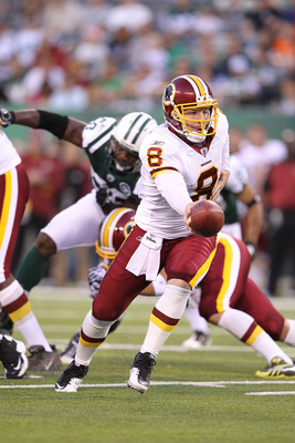 EAST RUTHERFORD, NJ - AUGUST 27:  Rex Grossman #8  of the Washington Redskins in action against  the New York Jets during their preseason game on August 27, 2010 at the New Meadowlands Stadium  in East Rutherford, New Jersey.  (Photo by Al Bello/Getty Ima