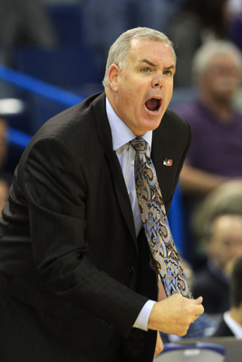 NEW ORLEANS, LA - MARCH 24:  Head coach Dave Rose of the Brigham Young Cougars yells to his team during their game against the Florida Gators in the Southeast regional of the 2011 NCAA men's basketball tournament at New Orleans Arena on March 24, 2011 in