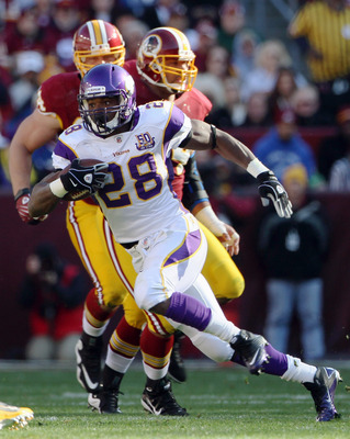 LANDOVER, MD - NOVEMBER 28:  Adrian Peterson #28 runs the ball in the first quarter against the Washington Redskins at FedExField November 28, 2010 in Landover, Maryland.  (Photo by Win McNamee/Getty Images)