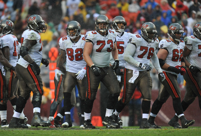 LANDOVER, MD - DECEMBER 12:  Derek Hardman #73 of the Tampa Bay Buccaneers walks up to the line of scrimmage with the defensive line during the game against the Washington Redskins  at FedExField on December 12, 2010 in Landover, Maryland. The Buccaneers