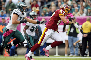 PHILADELPHIA - OCTOBER 03:  Chris Cooley #47 of the Washington Redskins runs in a reception for a first quarter touchdown past Stewart Bradley #55 of the Philadelphia Eagles on October 3, 2010 at Lincoln Financial Field in Philadelphia, Pennsylvania.  (Ph