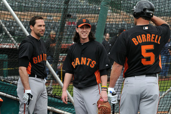SCOTTSDALE, AZ - FEBRUARY 19:  Tim Lincecum #55 of the San Francisco Giants (center) talks to teammates Pat Burrell #5 and Mark DeRosa #7 during batting practice at Scottsdale Stadium on February 19, 2011 in Scottsdale, Arizona.  (Photo by Norm Hall/Getty