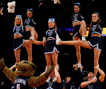 NEW YORK - MARCH 13:  The Villanova Wildcats cheerleaders and mascot perform as Terrence Jennings #23 of the Louisville Cardinals walks off of the court during the semifinal round of the Big East Tournament at Madison Square Garden on March 13, 2009 in Ne