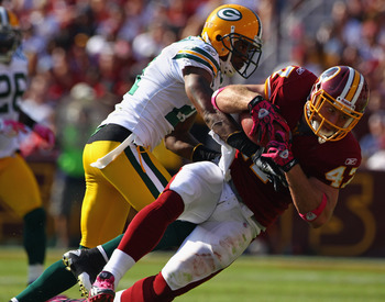 LANDOVER, MD - OCTOBER 10:  Tight end Chris Cooley #47 of the Washington Redskins is tackled by Charles Woodson #21 of the Green Bay Packers at FedExField on October 10, 2010 in Landover, Maryland. The Redskins won the game in overtime 16-13.  (Photo by W
