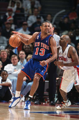 13 Dec 2001:  Point guard Mark Jackson #13 of the New York Knicks posts up point guard Chucky Atkins #7 of the Detroit Pistons during the NBA game at the Palace of Auburn Hills in Detroit, Michigan. The Pistons defeated the Knicks 99-97. NOTE TO USER:  Us