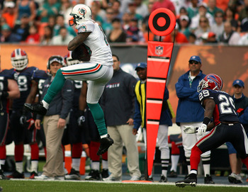 MIAMI, FL - DECEMBER 19:  Receiver Brandon Marshall #19 of the Miami Dolphins makes a catch during a game against the Buffalo Bills at Sun Life Stadium on December 19, 2010 in Miami, Florida. The Bills defeated the Dolphins 17-14.  (Photo by Marc Serota/G