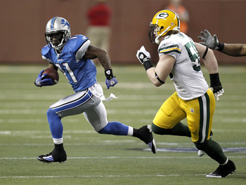 DETROIT, MI - DECEMBER 12:  Stefan Logan #11 of the Detroit Lions tries to get around A.J. Hawk #50 of the Green Bay Packers on December 12, 2010 at Ford Field in Detroit, Michigan. Detroit won the game 7-3  (Photo by Gregory Shamus/Getty Images)