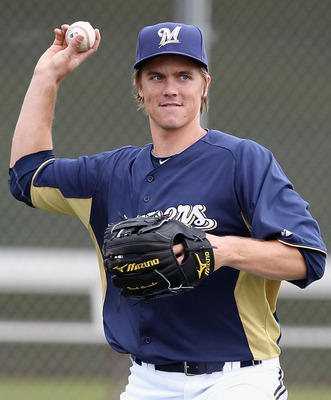 PHOENIX, AZ - FEBRUARY 18:  Pitcher Zack Greinke #13 of the Milwaukee Brewers participates in fielding drills during a MLB spring training practice at Maryvale Baseball Park on February 18, 2011 in Phoenix, Arizona.  (Photo by Christian Petersen/Getty Ima