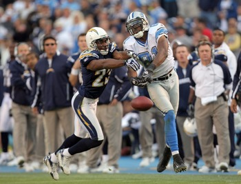 SAN DIEGO - DECEMBER 16:  Calvin Johnson #81 of the Detroit Lions tries to catch a pass as he is defended by Quentin Jammer #23 of the San Diego Chargers during the fourth quarter at Qualcomm Stadium December 16, 2007 in San Diego California.  (Photo by H
