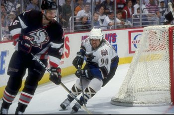 2 Jun 1998: Joe Juneau #90 of the Washington Capitals in action during an Eastern Conference Playoff game against the Buffalo Sabres at the MCI Center in Washington D.C.. The Sabres defeated the Capitals 2-1.