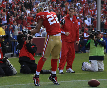 SAN FRANCISCO - DECEMBER 12:  Nate Clements #22 of the San Francisco 49ers celebrates after an interception against the Seattle Seahawks during an NFL game at Candlestick Park on December 12, 2010 in San Francisco, California.(Photo by Jed Jacobsohn/Getty