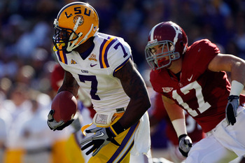 BATON ROUGE, LA - NOVEMBER 06:  Patrick Peterson #7 of the Louisiana State University Tigers avoids a tackle by Brad Smelley #17 of the Alabama Crimson Tide  at Tiger Stadium on November 6, 2010 in Baton Rouge, Louisiana.  (Photo by Chris Graythen/Getty I