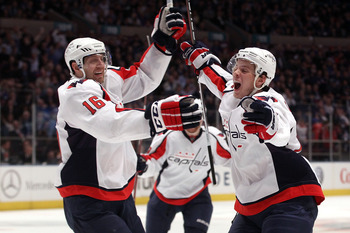 NEW YORK, NY - APRIL 20:  (L-R) Eric Fehr #16 and John Carlson #74 of the Washington Capitals celebrate after Marcus Johansson #90 scored a goal in the third period to tie the game 3-3 againsnt the New York Rangers in Game Four of the Eastern Conference Q