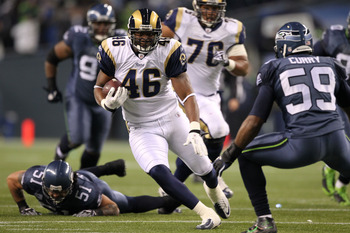 SEATTLE, WA - JANUARY 02:  Tight end Daniel Fells #46 of the St. Louis Rams runs with the ball after a catch against the Seattle Seahawks during their game at Qwest Field on January 2, 2011 in Seattle, Washington.  (Photo by Otto Greule Jr/Getty Images)