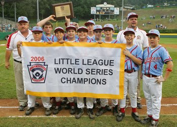 SOUTH WILLIAMSPORT, PA - AUGUST 28:  The Southeast team from Columbus, Georgia pose with their banner after defeating the Asian team from Kawaguchi City, Japan during the Championship game of the Little League World Series on August 28, 2006 at Lamade Sta