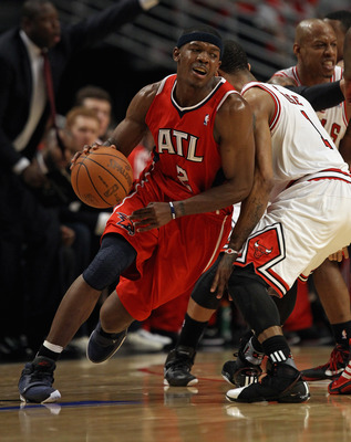 CHICAGO, IL - MAY 10: Joe Johnson #2 of the Atlanta Hawks moves around Derrick Rose #1 of the Chicago Bulls in Game Five of the Eastern Conference Semifinals in the 2011 NBA Playoffs at the United Center on May 10, 2011 in Chicago, Illinois. The Bulls def