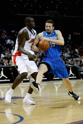 CHARLOTTE, NC - FEBRUARY 20:  Hedo Turkoglur #15 of the Orlando Magic drives to the basket past DeSagana Diop #7 of the Charlotte Bobcats during their game on February 20, 2009 at Time Warner Cable Arena  in Charlotte, North Carolina.  The Magic won 92-80