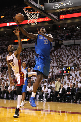 MIAMI, FL - MAY 31:  Brendan Haywood #33 of the Dallas Mavericks goes up for a shot against Udonis Haslem #40 of the Miami Heat in the third quarter in Game One of the 2011 NBA Finals at American Airlines Arena on May 31, 2011 in Miami, Florida. NOTE TO U
