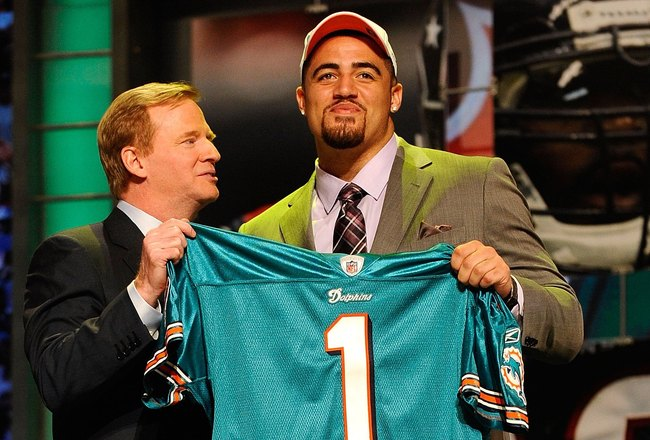 NEW YORK - APRIL 22:  Jared Odrick (R) from Penn State poses with NFL Commissioner Roger Goodell as they hold up a Miami Dolphins jersey after the Dolphins selected Odrick number 28 overall during the first round of the 2010 NFL Draft at Radio City Music