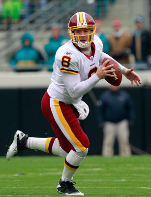 JACKSONVILLE, FL - DECEMBER 26: Quarterback Rex Grossman #8 of the Washington Redskins scrambles for yardage during the game against the Jacksonville Jaguars at EverBank Field on December 26, 2010 in Jacksonville, Florida.  (Photo by Sam Greenwood/Getty I