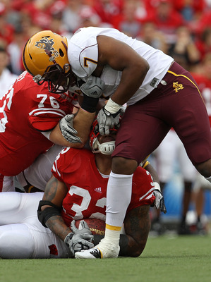 MADISON, WI - SEPTEMBER 18: John Clay #32 of the Wisconsin Badgers is tackled by the fask mask by Vontaze Burfict #7 of the Arizona State Sun Devils at Camp Randall Stadium on September 18, 2010 in Madison, Wisconsin. (Photo by Jonathan Daniel/Getty Image