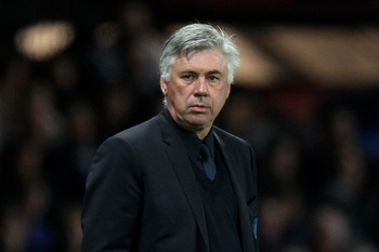 MANCHESTER, ENGLAND - APRIL 12:  Chelsea Manager Carlo Ancelotti looks on during the UEFA Champions League Quarter Final second leg match between Manchester United and Chelsea at Old Trafford on April 12, 2011 in Manchester, United Kingdom.  (Photo by Ale