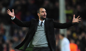 BARCELONA, SPAIN - MARCH 08:  Josep Guardiola the Barcelona coach celebrates  during the UEFA Champions League round of 16 second leg match between Barcelona and Arsenal at the Nou Camp Stadium on March 8, 2011 in Barcelona, Spain.  (Photo by Shaun Botter