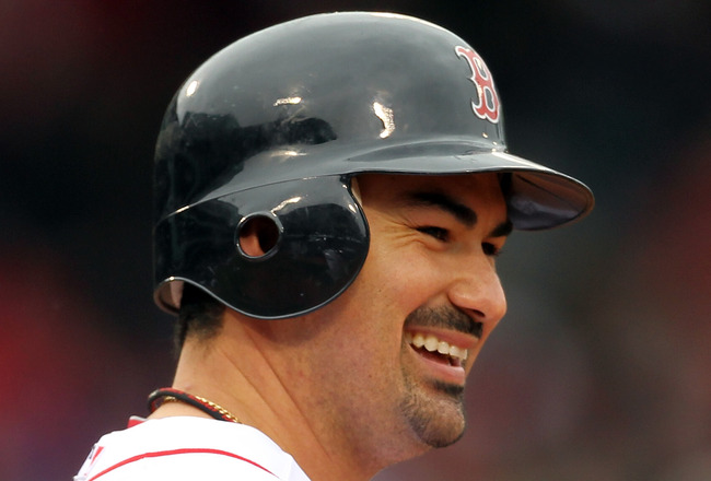 BOSTON, MA - APRIL 16, 2011:  Adrian Gonzalez #28 of the Boston Red Sox reacts against the Toronto Blue Jays at Fenway Park April 16, 2011 in Boston, Massachusetts. (Photo by Jim Rogash/Getty Images)