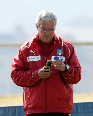 CENTURION, SOUTH AFRICA - JUNE 22:  Head coach Marcello Lippi looks at his phone during an Italy training session ahead of their 2010 FIFA World Cup Group Stage Round 3 Group F match against Slovakia  on June 22, 2010 in Centurion, South Africa.  (Photo b
