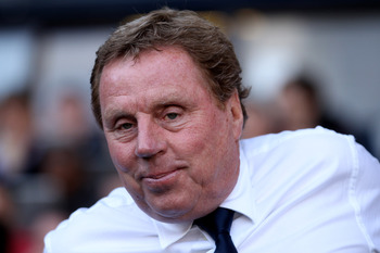 LONDON, ENGLAND - APRIL 09: Manager Harry Redknapp of Spurs smiles during the Barclays Premier League match between Tottenham Hotspur and Stoke City at White Hart Lane on April 9, 2011 in London, England.  (Photo by Ian Walton/Getty Images)