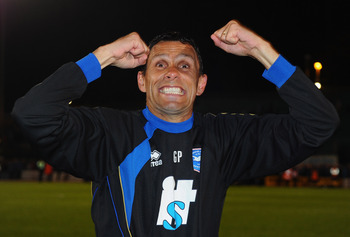 BRIGHTON, ENGLAND - APRIL 12:  Brighton manager Gus Poyet celebrates promotion after the npower League One match between Brighton & Hove Albion and Dagenham & Redbridge at Withdean Stadium on April 12, 2011 in Brighton, United Kingdom.  (Photo by Mike Hew