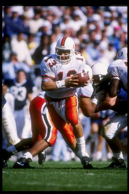 10 Oct 1992:  Quarterback Gino Torretta of the Miami Hurricanes drops back during a game against the Penn State Nittany Lions at Beaver Stadium in University Park, Pennsylvania.  Miami won the game 17-14. Mandatory Credit: Gene Sweeney  /Allsport