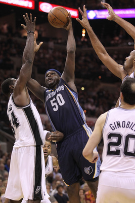 SAN ANTONIO, TX - APRIL 20:  Forward Zach Randolph #50 of the Memphis Grizzlies takes a shot against Antonio McDyess #34 of the San Antonio Spurs in Game Two of the Western Conference Quarterfinals in the 2011 NBA Playoffs on April 20, 2011 at AT&T Center