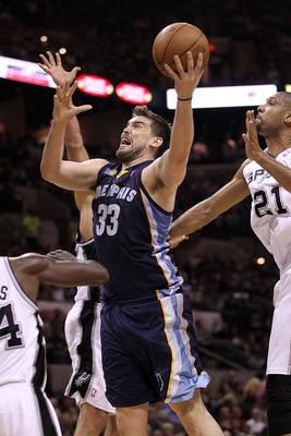 SAN ANTONIO, TX - APRIL 20:  Center Marc Gasol #33 of the Memphis Grizzlies takes a shot against Antonio McDyess #34 of the San Antonio Spurs in Game Two of the Western Conference Quarterfinals in the 2011 NBA Playoffs on April 20, 2011 at AT&T Center in
