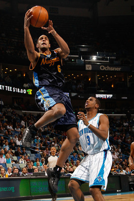 NEW ORLEANS - DECEMBER 18:  Arron Affalo #6 of the Denver Nuggets makes a shot over Chris Paul #3 of the New Orleans Hornets at New Orleans Arena on December 18, 2009 in New Orleans, Louisiana.  The Hornets defeated the Nuggets 98-92.   NOTE TO USER: User
