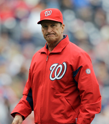 WASHINGTON, DC - APRIL 03: Jim Riggleman #5 manager of the Washington Nationals walks off the field after a pitching change against the Atlanta Braves during the seventh inning at Nationals Park on April 3, 2011 in Washington, DC.  (Photo by Rob Carr/Gett