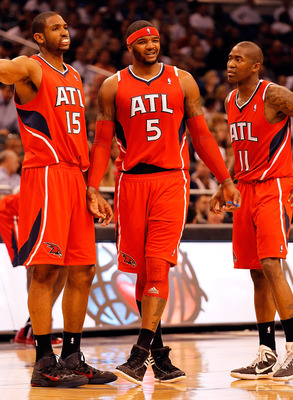 ORLANDO, FL - APRIL 19:  Josh Smith #5 of the Atlanta Hawks stands with Al Horford #15 and Jamal Crawford #11 after a technical foul is called on Smith against the Orlando Magic during Game Two of the Eastern Conference Quarterfinals of the 2011 NBA Playo