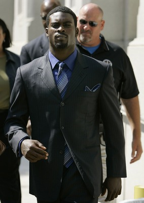 RICHMOND, VA - JULY 26:   Atlanta Falcons quarterback Michael Vick leaves the federal courthouse following his arraignment on July 26, 2007 in Richmond, Virginia. Vick pleaded not guilty Thursday to federal dogfighting charges and was released without bon