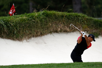 PEBBLE BEACH, CA - JUNE 20:  Tiger Woods plays from a greenside bunker on the 14th hole during the final round of the 110th U.S. Open at Pebble Beach Golf Links on June 20, 2010 in Pebble Beach, California.  (Photo by Donald Miralle/Getty Images)