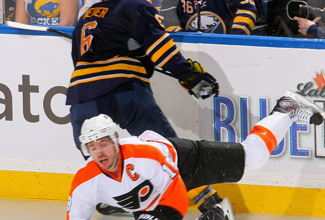 BUFFALO, NY - APRIL 20: Mike Richards #18 of the Philadelphia Flyers falls to the ice after being hit by Mike Weber #6 of the Buffalo Sabres  in Game Four of the Eastern Conference Quarterfinals during the 2011 NHL Stanley Cup Playoffs at HSBC Arena at HS