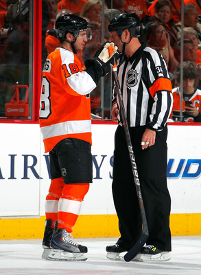 PHILADELPHIA, PA - APRIL 16:  Mike Richards #18 of the Philadelphia Flyers talks with referee Brad Meier #34 in Game Two of the Eastern Conference Quarterfinals against the Buffalo Sabres during the 2011 NHL Stanley Cup Playoffs at Wells Fargo Center on A
