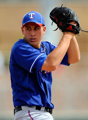 GLENDALE, AZ - MARCH 15:  Pitcher Derek Holland #45 of the Texas Rangers  throws a pitch against the Los Angeles Dodgers during the spring training baseball game at Camelback Ranch on March 15, 2011 in Glendale, Arizona.  (Photo by Kevork Djansezian/Getty