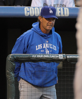 DENVER, CO - APRIL 05:  Manager Don Mattingly  of the Los Angeles Dodgers oversees the action as his team faces the Colorado Rockies at Coors Field on April 5, 2011 in Denver, Colorado. The Rockies defeated the Dodgers 3-0.  (Photo by Doug Pensinger/Getty