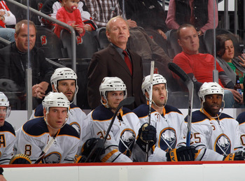NEWARK, NJ - NOVEMBER 10:  Head coach Lindy Ruff of the Buffalo Sabres works his 1000th NHL game against the New Jersey Devils at the Prudential Center on November 10, 2010 in Newark, New Jersey.  (Photo by Bruce Bennett/Getty Images)